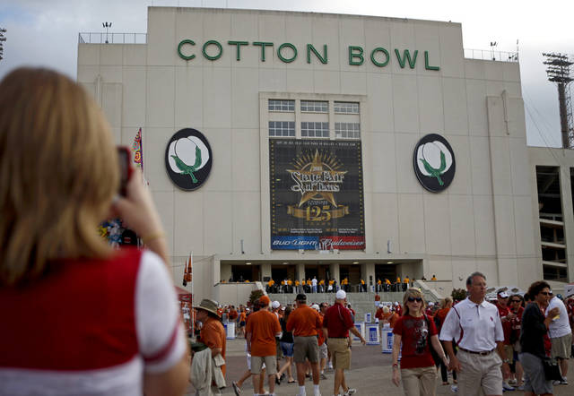 Fans walk outside the Cotton Bowl before the Red River Rivalry college football game between the University of Oklahoma Sooners (OU) and the University of Texas Longhorns (UT) at the Cotton Bowl in Dallas, Saturday, Oct. 8, 2011. Photo by Bryan Terry, The Oklahoman