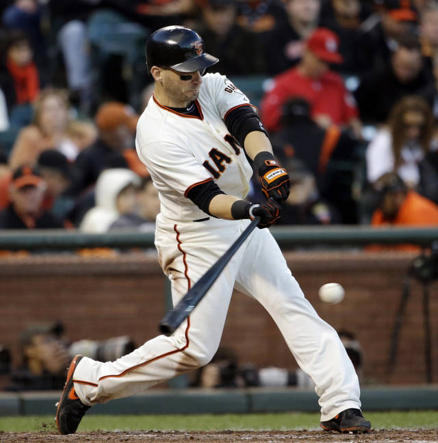 San Francisco Giants' Marco Scutaro hits a single during the fourth inning of Game 6 of baseball's National League championship series against the St. Louis Cardinals Sunday, Oct. 21, 2012, in San Francisco. (AP Photo/David J. Phillip)