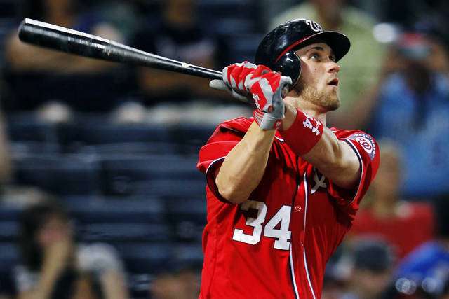   FILE - In this May 27, 2012, file photo, Washington Nationals&#039; Bryce Harper (34) follows through with a solo home run in the eighth inning of a baseball game against the Atlanta Braves in Atlanta. Harper was named the National League Rookie of the Year Monday, Nov. 12. (AP Photo/John Bazemore, File)  
