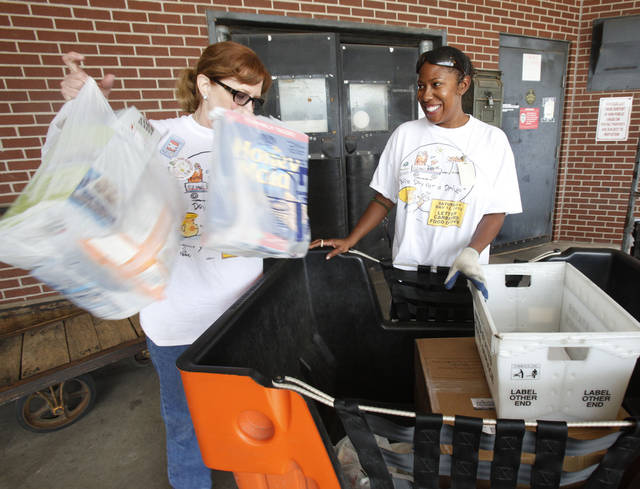 Dawn Burroughs, with the Food Bank, (left) and letter carrier Tanika Glover unload donated food during the Letter Carriers' Food Drive at the 301 W Britton Road Post Office in Oklahoma City, OK, Saturday, May 12, 2012,  By Paul Hellstern, The Oklahoman