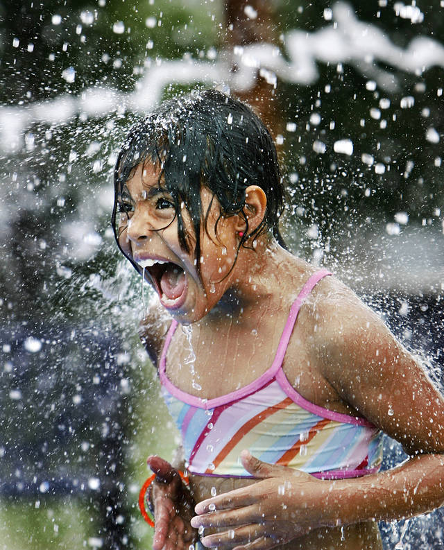 Suzeth Gallegos, 8, screams as she is sprayed with water at the sprayground in Wiley Post Park, SW 17 and Robinson, Friday, June 6, 2008.  BY JIM BECKEL, THE OKLAHOMAN