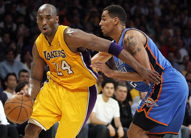 Los Angeles' Kobe Bryant (24) drives past Oklahoma City's Thabo Sefolosha (2) during Game 4 in the second round of the NBA basketball playoffs between the L.A. Lakers and the Oklahoma City Thunder at the Staples Center in Los Angeles, Saturday, May 19, 2012. Photo by Nate Billings, The Oklahoman