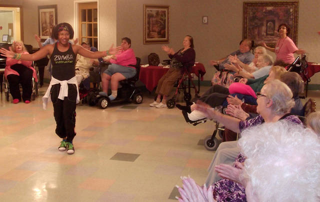 Tori Collier leads a Zumba session at Grace Living Center in Norman. Her visits have become popular with  residents and staff members. Photo  provided by Grace Living Center. <strong>PROVIDED - PROVIDED</strong>
