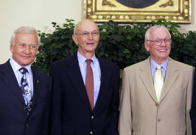 "In this July 20, 2009, photo, Buzz Aldrin, left, Michael Collins, center, and Neil Armstrong stand in the Oval Office at the White House in Washington, on the 40th anniversary of the Apollo 11 moon landing. Neil Armstrong was a quiet self-described nerdy engineer who became a global hero when as a steely-nerved pilot he made ""one giant leap for mankind"" with a small step on to the moon. The modest man who had people on Earth entranced and awed from almost a quarter million miles away has died. He was 82. (AP Photo/Alex Brandon) ORG XMIT: WX117"