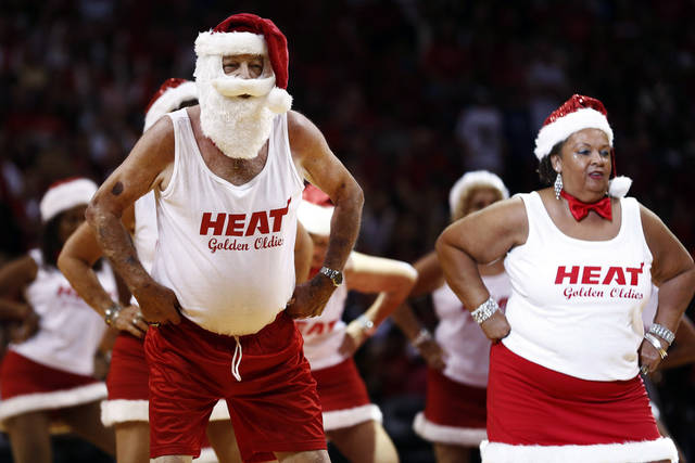 The Miami Heat Golden Oldies perform during the first half of an NBA basketball game between the Heat and the Oklahoma City Thunder, Tuesday, Dec. 25, 2012, in Miami. (AP Photo/J Pat Carter) ORG XMIT: FLJC105