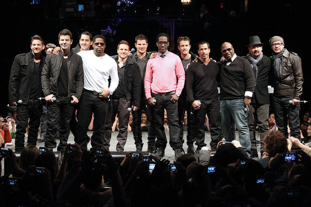 Members of 98 Degrees, Boyz II Men, and New Kids on the Block, greet fans Tuesday during the announcement of �The Package Tour,� in New York. The summer tour will feature the three bands.  AP Photo/Starpix, Kristina Bumphrey