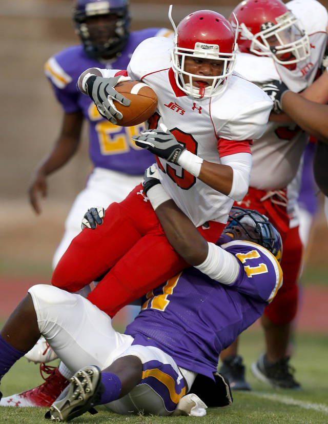 Western Heights' Xavier McLaurin scores a touchdown over Northwest Classen's Isaiah Beverly during a high school football game at Taft Stadium in Oklahoma City, Thursday, September 20, 2012. Photo by Bryan Terry, The Oklahoman
