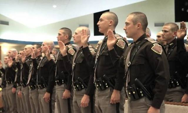 Thirty Oklahoma Highway Patrol troopers take the oath during their graduation at True Vine Baptist Church, Friday, August 17, 2012. This is the first class in more than three years. Photo By David McDaniel