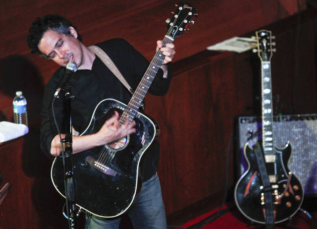"In this photograph taken March 14, 2012, M. Ward performs at the Central Presbyterian Church during the SXSW Music Festival in Austin, Texas. Ward's latest album ""A Wasteland Companion,"" is his first solo album in three years. (AP Photo/Jack Plunkett, file)"