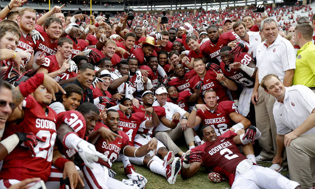 The Oklahoma team poses for a photo after the Red River Rivalry college football game between the University of Oklahoma (OU) and the University of Texas (UT) at the Cotton Bowl in Dallas, Saturday, Oct. 13, 2012. Oklahoma won 63-21. Photo by Bryan Terry, The Oklahoman