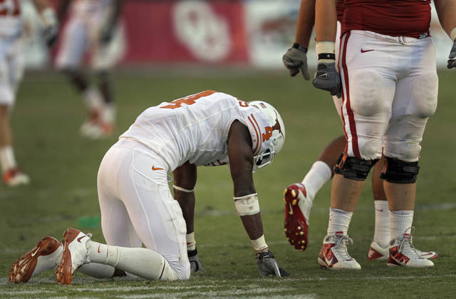 Texas' Aaron Williams (4) reacts after fumbling a kick return in the final minute of the second half in the Red River Rivalry college football game between the University of Oklahoma Sooners (OU) and the University of Texas Longhorns (UT) at the Cotton Bowl on Saturday, Oct. 2, 2010, in Dallas, Texas.   Photo by Chris Landsberger, The Oklahoman