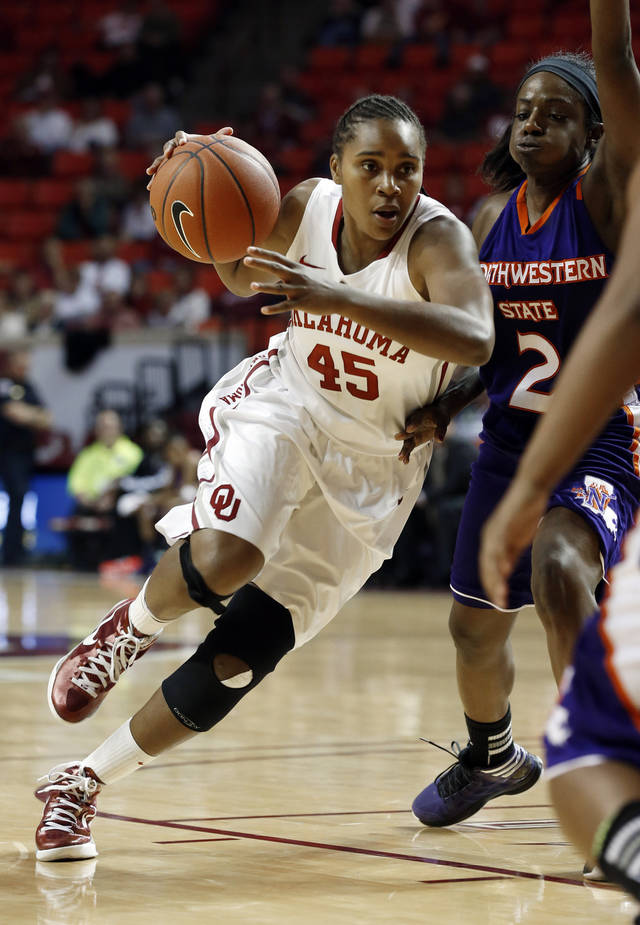 Oklahoma Sooners' Jasmine Hartman (45) drives around Northwestern State Lady Demons' Tiandra Williams (2) during the second half as the University of Oklahoma (OU) Sooner women's basketball team plays the Northwestern State Lady Demons at the Lloyd Noble Center on Thursday, Nov. 29, 2012  in Norman, Okla. Photo by Steve Sisney, The Oklahoman