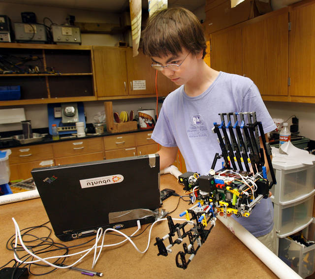 University of Oklahoma (OU) freshman Nils Schlupp works on a robot for Botball competition at Norman High School in Norman, Oklahoma on Wednesday, July 2, 2008.  BY STEVE SISNEY, THE OKLAHOMAN