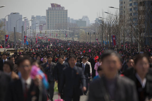 In this Sunday, April 15, 2012 photo, people walk down a street after a large military parade in Pyongyang's Kim Il Sung Square celebrating 100 years since the birth of the late North Korean founder Kim Il Sung. (AP Photo/David Guttenfelder)