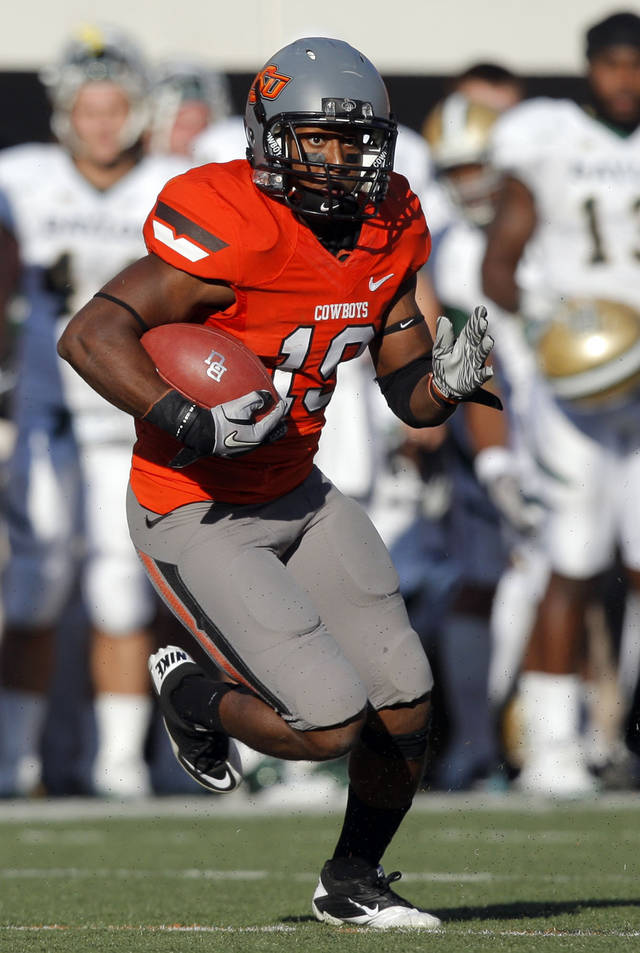 Oklahoma State&#039;s Brodrick Brown (19) returns an interception in the third quarter of a college football game between the Oklahoma State University Cowboys (OSU) and the Baylor University Bears (BU) at Boone Pickens Stadium in Stillwater, Okla., Saturday, Oct. 29, 2011. Photo by Sarah Phipps, The Oklahoman