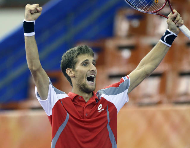 Martin Klizan of Slovakia celebrates his 6-7, 6-4, 7-6 victory in the St. Petersburg Open ATP tennis tournament semifinal match over Mikhail Youzhny of Russia in St.Petersburg, Russia, Saturday, Sept. 22, 2012. (AP Photo/Dmitry Lovetsky)