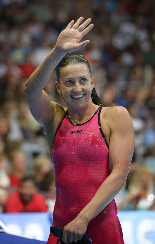 FILE-In this Saturday, June 30, 2012 file photo, Rebecca Soni waves to the crowd after winning the women's 200-meter breaststroke final in Omaha, Neb., at the U.S. Olympic swimming trials. Soni, of Plainsboro, N.J., will compete in the 100-meter and 200-meter breaststroke race in her second Olympics. Soni also competed in the 2008 Olympics, winning a gold medal and two silver medals. (AP Photo/Mark J. Terrill, File)