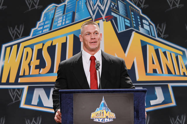 In this Thursday, Feb. 16, 2012 photo, World Wrestling Entertainment personality John Cena speaks at a news conference in East Rutherford, N.J., to announce that MetLife Stadium will host WrestleMania XXIX on April 7, 2013. WWE is joining with New York Mayor Michael Bloomberg, New Jersey Gov. Chris Christie, Hollywood celebrities and professional athletes to launch Superstars for Sandy Relief. Fans can bid on hundreds of items in an online auction, including attending a NASCAR race with Cena, meeting Tyra Banks on the set of �America's Next Top Model,� or pitching entrepreneurial ideas to Mark Cuban. The auction begins Monday, March 25, 2013, and closes April 9 on charitybuzz.com. (AP Photo/StarPix, Dave Allocca)