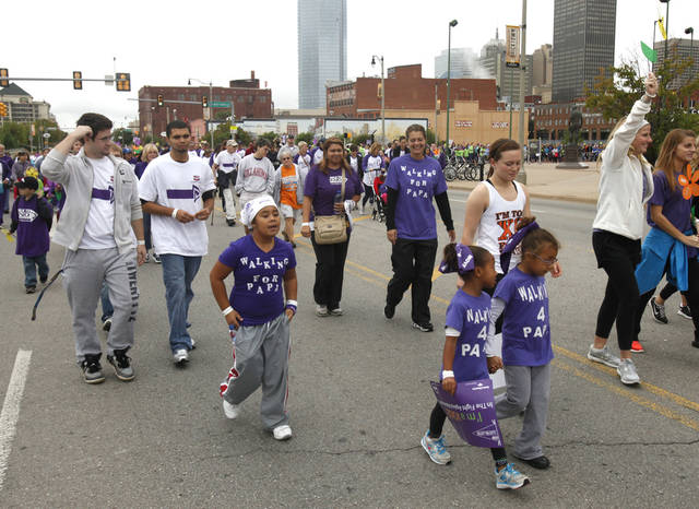 Walkers near the finish line during the 2012 Oklahoma City Walk to End Alzheimer's at Bricktown Ballpark in Oklahoma City, OK, Saturday, September 15, 2012,  By Paul Hellstern, The Oklahoman