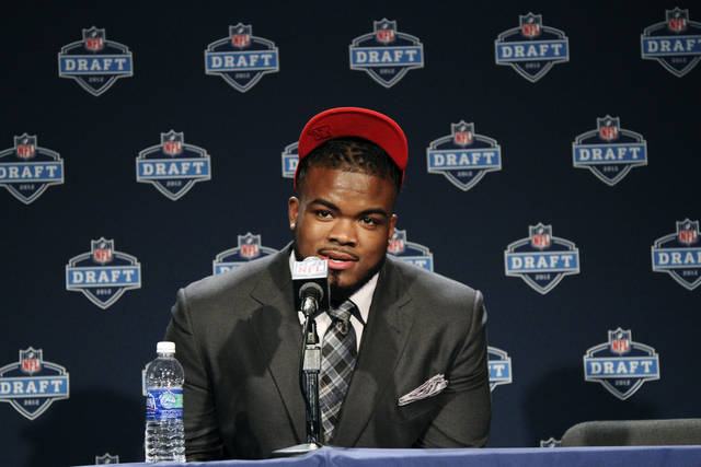 Memphis defensive tackle Dontari Poe speaks to reporters after being selected as the 11th pick overall by the Kansas City Chiefs in the first round of the NFL football draft at Radio City Music Hall, Thursday, April 26, 2012, in New York. (AP Photo/Mary Altaffer)
