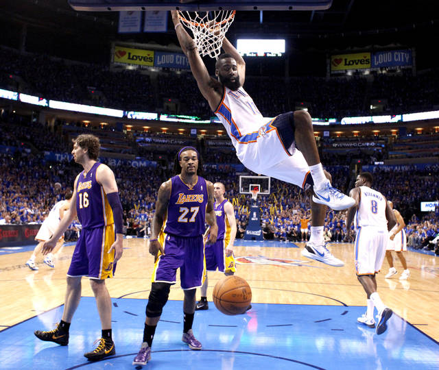 Oklahoma City's James Harden (13) hangs on the rim after dunking the ball as Los Angeles' Pau Gasol (16) and Los Angeles' Jordan Hill (27) look on during Game 1 in the second round of the NBA playoffs between the Oklahoma City Thunder and the L.A. Lakers at Chesapeake Energy Arena in Oklahoma City, Monday, May 14, 2012. Photo by Sarah Phipps, The Oklahoman