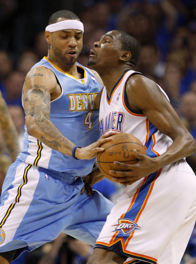 Oklahoma City's Kevin Durant (35) runs into Denver's Kenyon Martin (4) during the NBA basketball game between the Denver Nuggets and the Oklahoma City Thunder in the first round of the NBA playoffs at the Oklahoma City Arena, Sunday, April 17, 2011. Photo by Bryan Terry, The Oklahoman