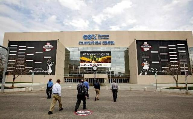 Pedestrians to the Cox Convention Center where banners for the Big 12 Men's and Women's basketball championship hang outside on Tuesday, March 7, 2009, in Oklahoma City, Okla. Photo by Chris Landsberger.