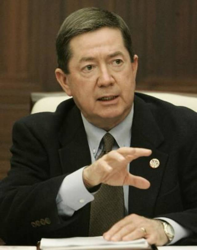 Oklahoma state Attorney General  Drew  Edmondson gestures as he speaks Friday, Feb. 13, 2009, at a news conference, saying that it is &quot;highly likely&quot; that poultry litter spread across pastures in Mayes County was the source of E. coli bacteria that contaminated well water at a restaurant in Locust Grove last year, killing one person and sickening more than 300 others. (AP Photo/Sue Ogrocki) 