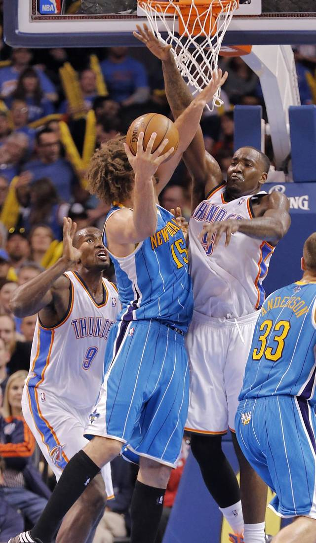 Oklahoma City Thunder's Serge Ibaka (9) and Kendrick Perkins (5) defend on New Orleans Hornets' Robin Lopez (15) during the NBA basketball game between the Oklahoma City Thunder and the New Orleans Hornets at the Chesapeake Energy Arena on Wednesday, Feb. 27, 2013, in Oklahoma City, Okla. Photo by Chris Landsberger, The Oklahoman