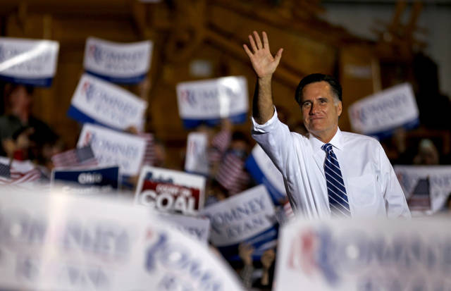 Republican presidential candidate, former Massachusetts Gov. Mitt Romney waves to supporters as he takes the stage to speak at a campaign event at Screen Machine Industries, Friday, Nov. 2, 2012, in Etna, Ohio. (AP Photo/David Goldman)