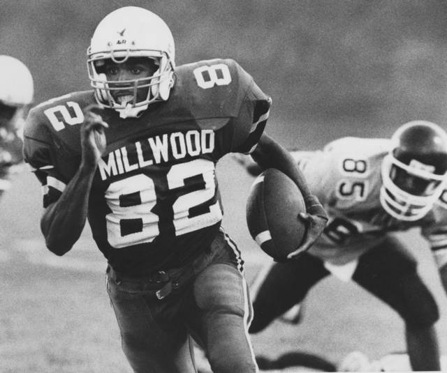 HIGH SCHOOL FOOTBALL: Millwood's Mandrell Dean runs away from a Northeast defender during Thursday night's Falcons victory, Sept. 13, 1990, in Oklahoma City.  By Doug Hoke, The Oklahoman.  ORG XMIT: KOD