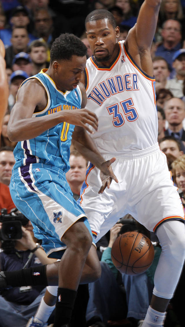 Oklahoma City Thunder's Daniel Orton (33) defends on New Orleans Hornets' Al-Farouq Aminu (0) during the NBA basketball game between the Oklahoma CIty Thunder and the New Orleans Hornets at the Chesapeake Energy Arena on Wednesday, Dec. 12, 2012, in Oklahoma City, Okla.   Photo by Chris Landsberger, The Oklahoman