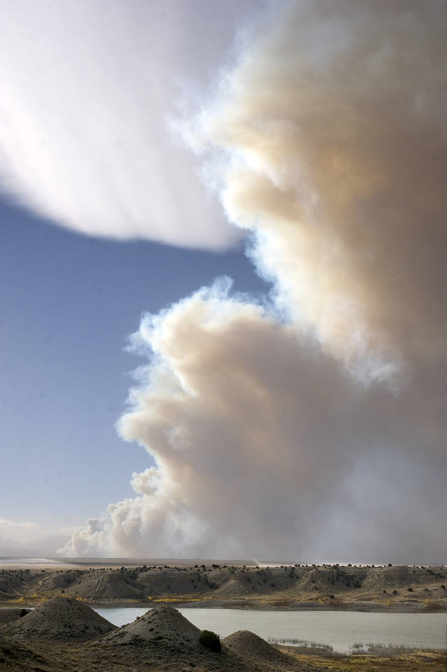 Smoke billows from a wildfire near Wetmore, Colo., Tuesday, Oct. 23, 2012. Residents of the small town approximately 30 minutes west of Pueblo, Colorado are being asked to evacuate with shelters for both people and animals being set up in Pueblo. (AP Photo/The Chieftain, Bryan Kelsen)