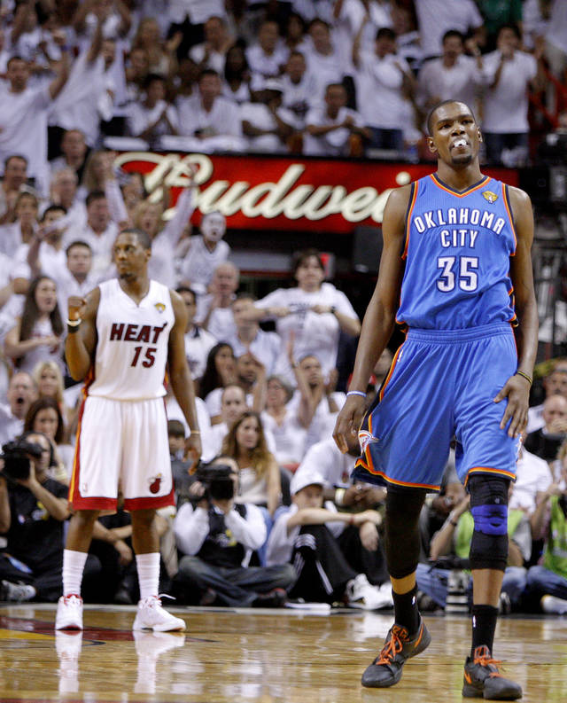 Oklahoma City's Kevin Durant (35) reacts in front of Miami's Mario Chalmers (15) during Game 3 of the NBA Finals between the Oklahoma City Thunder and the Miami Heat at American Airlines Arena, Sunday, June 17, 2012.  Oklahoma City lost 91-85.  Photo by Bryan Terry, The Oklahoman