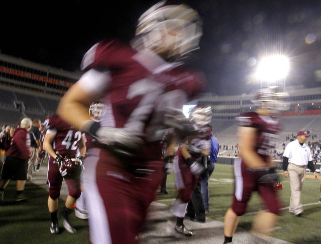 Jenks players run off the field during the Class 6A Oklahoma state championship football game between Norman North High School and Jenks High School at Boone Pickens Stadium on Friday, Nov. 30, 2012, in Stillwater, Okla.   Photo by Chris Landsberger, The Oklahoman