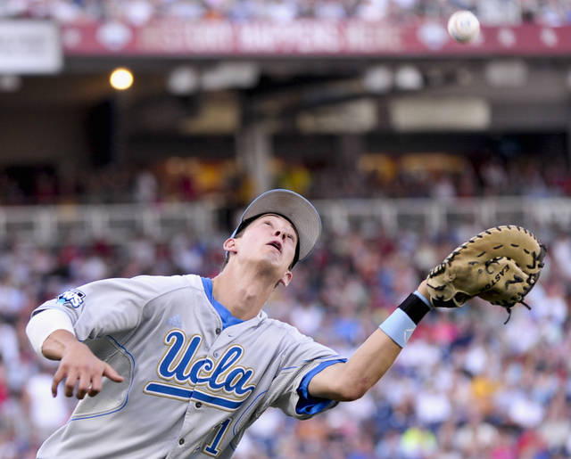 UCLA first baseman Trevor Brown catches a foul ball from a bunt by Florida State's Bert Givens in the second inning of an NCAA College World Series elimination baseball game in Omaha, Neb., Tuesday, June 19, 2012. (AP Photo/Ted Kirk)