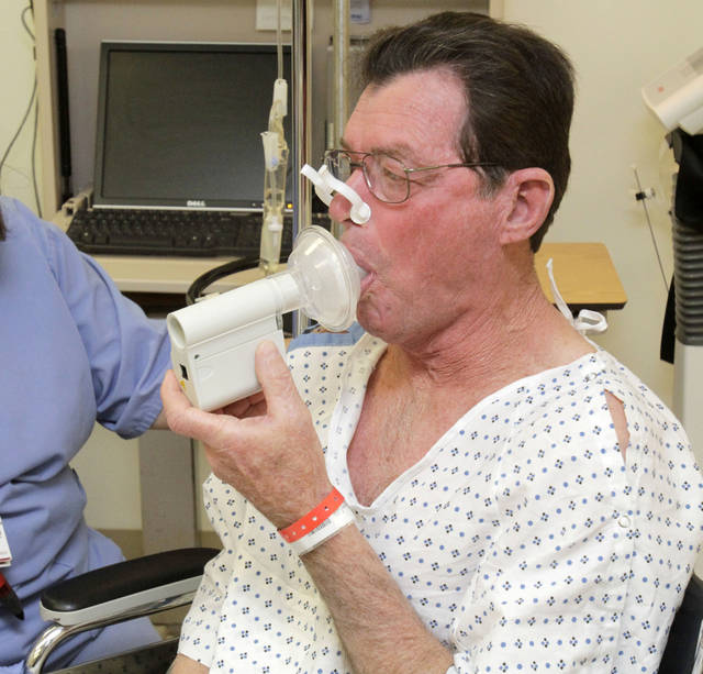 Robert Stuemky takes a test of his lung capacity before being treated with the Alair Bronchial Thermoplasty System at the OU Medical Center in Oklahoma City, OK, Friday, Jan. 13, 2012. The  former mountain climber developed severe asthma late in life. By Paul Hellstern, The Oklahoman