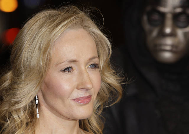 """FILE - A Thursday, Nov. 11, 2010 photo from files showing British author J K Rowling arriving at a cinema in London's Leicester Square for the World Premiere of Harry Potter and the Deathly Hallows Part 1. She may not be able to match the phenomenal success of the Harry Potter series, but J.K. Rowling has high hopes for """"The Casual Vacancy,"""" her first novel for adults. The title was announced Thursday, April 12, 2012, by Little, Brown & Co. along with a brief plot synopsis for the book.The publisher said it will be available worldwide on Sept. 27. (AP Photo/Joel Ryan, File)"""