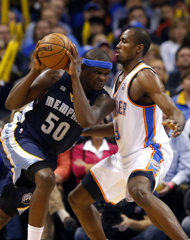 Oklahoma City's Serge Ibaka (9) defends against Memphis' Zach Randolph (50) during the NBA basketball game between the Oklahoma City Thunder and the Memphis Grizzlies at the Chesapeake Energy Arena in Oklahoma City,  Thursday, Jan. 31, 2013.Photo by Sarah Phipps, The Oklahoman