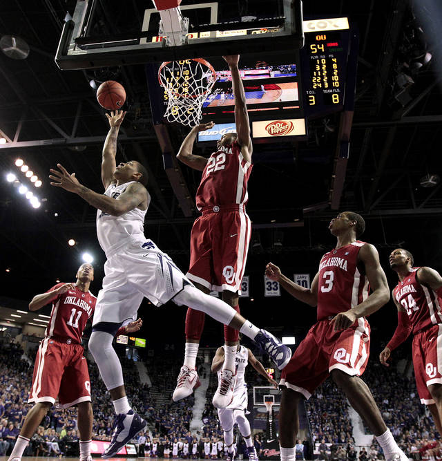 Kansas State guard Rodney McGruder (22) gets past Oklahoma forward Amath M'Baye (22) to put up a shot during the second half of an NCAA college basketball game on Saturday, Jan. 19, 2013, in Manhattan, Kan. Kansas State won the game 69-60. (AP Photo/Charlie Riedel)