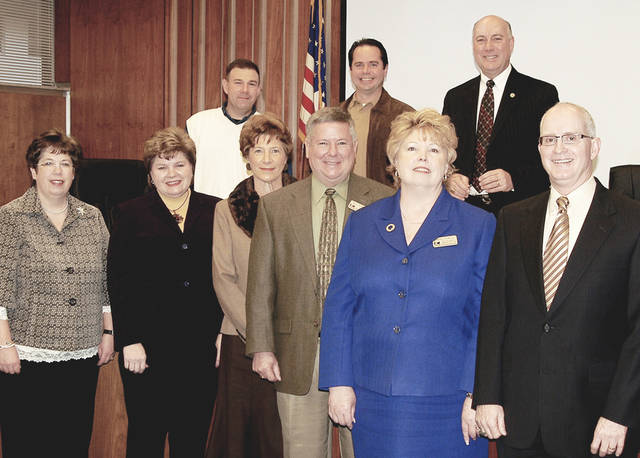 Edmond school administrators, left to right, Cathey Bugg, Cross Timbers; Paula Stafford, Russell Dougherty ; Joann Graham, Chisholm; Bill Powell, Clegern; Lynn Rowley, director of elementary education, and Superintendent David Goin. Back row, Joe Blough, Oklahoma County chief deputy District 1; Brent Rinehart, commissioner District 2; Ray Vaughn, commissioner District 3.  Photos provided by Rick Buchanan