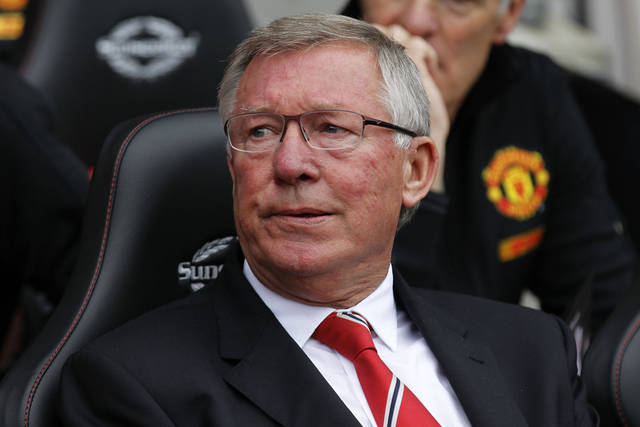 Southampton's Manchester United's manager Alex Ferguson, looks on from the dugout before the start of their English Premier League soccer match at St Mary's stadium, Southampton, England, Sunday, Sept. 2, 2012. Alex Ferguson marks his 1000th match in charge of Manchester United. (AP Photo/Sang Tan)