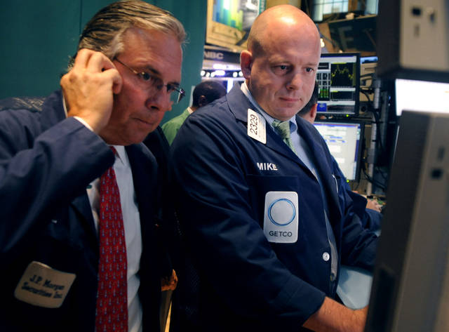 FILE - In this Sept. 12, 2012 file photo, Michael O'Connor, right, of Getco Securities and a fellow trader work on the floor of the New York Stock Exchange in New York. Futures are edging higher Wednesday, Sept. 19, ahead of a pair of reports regarding the U.S. housing market that are expected to provide more hope for the beleaguered industry. (AP Photo/Henny Ray Abrams, File)