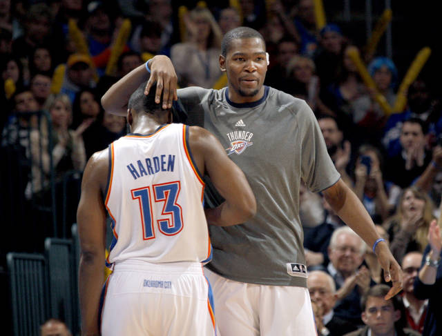 CELEBRATION: Oklahoma City Thunder's Kevin Durant (35) celebrates with Oklahoma City Thunder's James Harden (13) during the NBA basketball game between the Oklahoma City Thunder and the San Antonio Spurs at the Chesapeake Energy Arena in Oklahoma City, Sunday, Jan. 8, 2012. Photo by Sarah Phipps, The Oklahoman