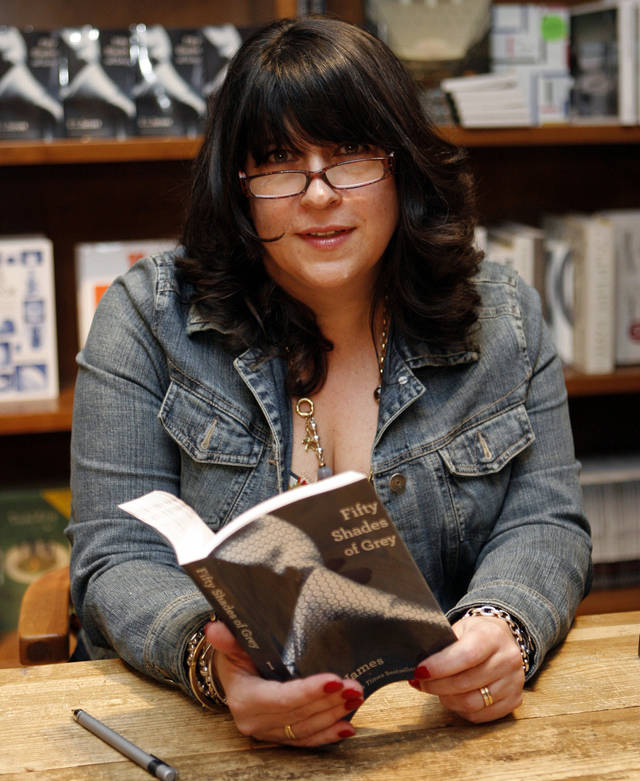 "Author E L James holds a copy of her erotic fiction book ""50 Shades of Grey"" at a book signing April 29 in Coral Gables, Fla. AP Photo"