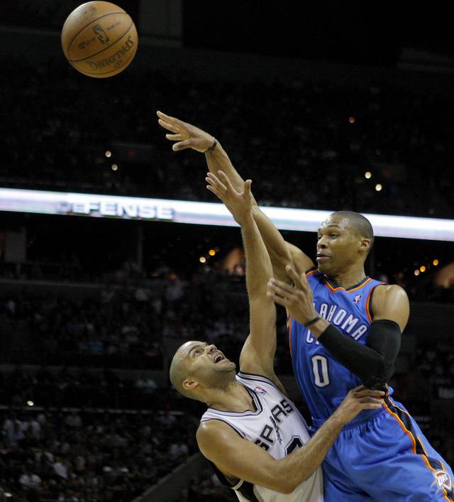 Oklahoma City's Russell Westbrook (0) passes the ball over San Antonio's Tony Parker (9) during Game 2 of the Western Conference Finals between the Oklahoma City Thunder and the San Antonio Spurs in the NBA playoffs at the AT&T Center in San Antonio, Texas, Tuesday, May 29, 2012. Photo by Bryan Terry, The Oklahoman