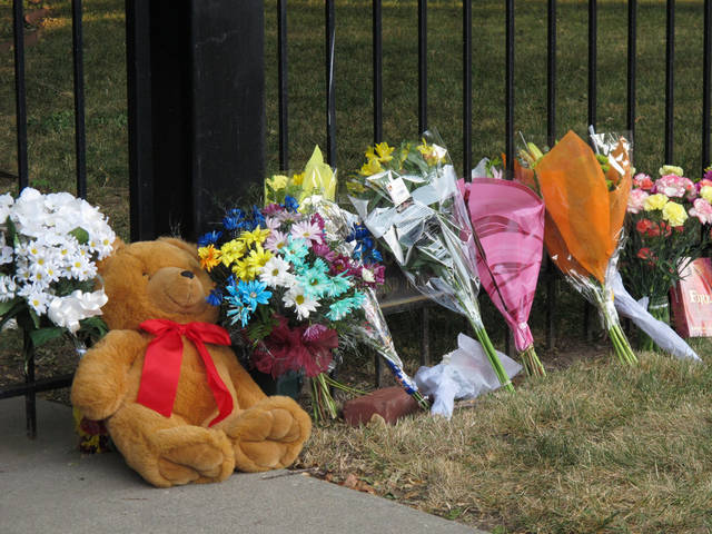 Friends and neighbors of Ron and Rebecca Bramlage and their four children leave flowers and other items at the fence of their home to honor them after their deaths, Thursday, June 7, 2012, in Junction City, Kan. The family died in a Florida plane crash. (AP Photo/John Hanna)