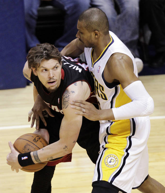 Indiana Pacers guard Leandro Barbosa, right, reaches around and fouls Miami Heat guard Mike Miller during the first half of Game 6 of their NBA basketball Eastern Conference semifinal playoff series in Indianapolis, Thursday, May 24, 2012. (AP Photo/Michael Conroy)