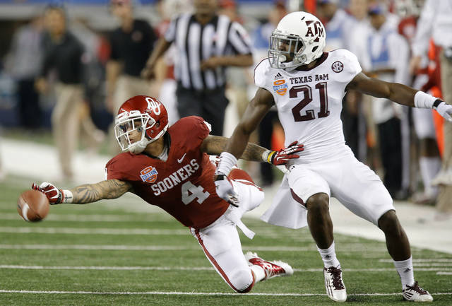 Texas A&M 's Steven Terrell (21) is called for  interference as Oklahoma's Kenny Stills (4) goes for the ball during the Cotton Bowl college football game between the University of Oklahoma (OU)and Texas A&M University at Cowboys Stadium in Arlington, Texas, Friday, Jan. 4, 2013. Photo by Bryan Terry, The Oklahoman