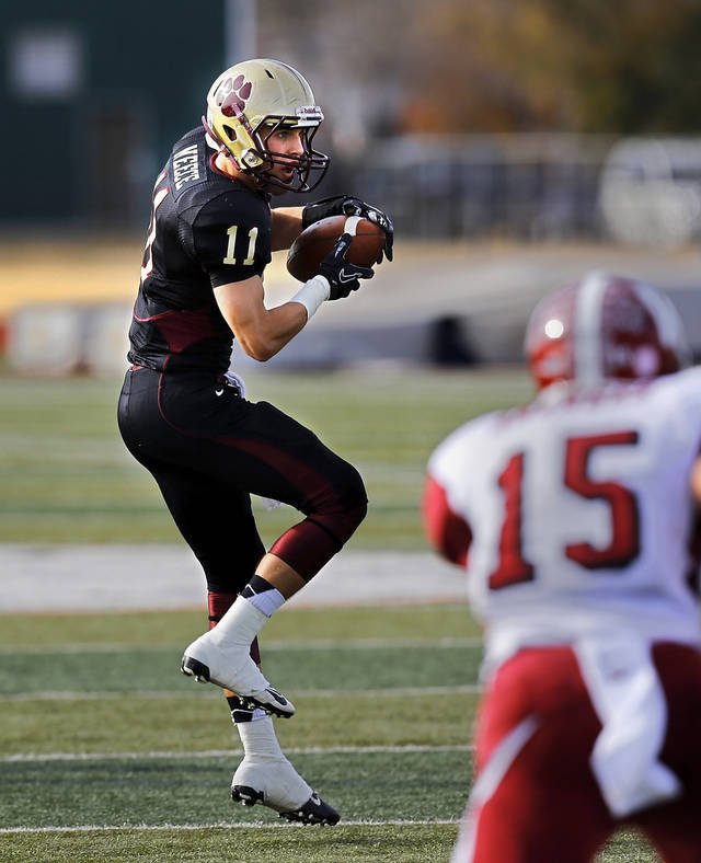 Cashion wide receiver Joe Neece is uncovered when he catches this pass. Approaching him is Wynnewood defender Jace Brown. Cashion vs. Wynnewood at Norman in a Class A semifinal football game, Saturday, Dec. 1, 2012.     Photo by Jim Beckel, The Oklahoman